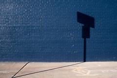 Shadow Hits A Brick Wall (-Dons) Tags: austin texas unitedstates shadow wall blue tx usa brick sidewalk