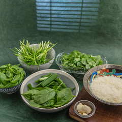 Baby spinach, scallion, cilantro, chives, garlic and grated parmesan. (annick vanderschelden) Tags: bowl grey spinach babyspinach chopped scallion green vegetables ingredients chives cilantro pesto paste food cooking gratedparmesan parmesan cheese grated