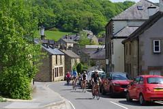 Eyam (Blue Sky Pix) Tags: cyclists eyam village derbysire peak district keepfit fun exercise derbyshire england sunshine pentax