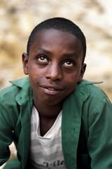 Young boy @ Entoto hill - Ethiopia (Steven Goethals) Tags: ethiopia ethiopie ethiopië etiopia portrait boy ethnic nice beautiful ethnology ethnique culture face visage travel human explore east africa people peoples adventure black skin afrique de lest valley goethals steven colorful fuji fujifilm xseries xt2 xf56 intense look addisababa entotohill