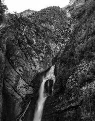 Slovenia (Bukshee) Tags: famous place international landmark slovenia europe southern nature outdoors travel wood water tree landscape waterfall forest land plant rainforest mountain valley vertical gray black white monochrome no people rock object destinations extreme terrain natural nonurban scene area woodland day