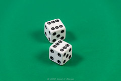Nicknames of dice in the game of craps (Sgt Morgan) Tags: boxcars casino craps dicegame gambling bones contest gamble game gamesofchance greenbackground midnight outcome wager whitedice