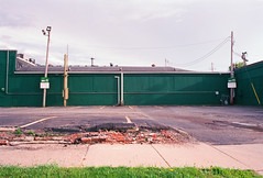 untitled-26 (dvlmnkillatron) Tags: 35mm film green broken parking lot champaign poles grass f1 canon