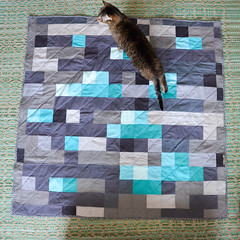Cat enjoying the Minecraft-inspired quilt, prior to washing & drying (osiristhe) Tags: cat dizzy quilting quilt sewing nikond5100 18200mm minecraft