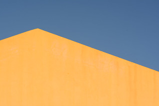 Yellow house and blue sky
