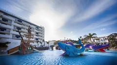 The Shark and the Sea Serpent (Riyazi) Tags: water resort blue boat amusementpark vacation leisure sea waterpark sky hotel tourism recreation harbor playground travel leisureactivities sitting riding beach swimmingpool large building ocean small