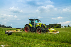Mowing Grass | CLAAS (martin_king.photo) Tags: springwork springwork2018 silage silage2018 claas claasaxion claasdisco mower inaction action first today outdoor claasworldwide machine sky martin king photo agriculture machinery machines tschechische republik powerfull power dynastyphotography lukaskralphotocz agricultural great day czechrepublic fans work place tschechischerepublik martinkingphoto welovefarming working modern landwirtschaft colorful colors blue photogoraphy photographer canon tractor love farming daily onwheels farm skyline allclaaseverything claasfans worker field green red clouds blusesky new cloudy grass rake hayrake