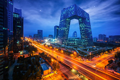 Night cityscape with bilding and road in Beijing city (anekphoto) Tags: beijing china cctv city district television headquarters architecture office central building urban buildings skyline modern landmark famous business night sky light capital traffic road sunset downtown cityscape new tower transportation skyscraper evening background landscape financial view peking high futuristic structure asian asia exterior chinese metropolis center dusk design scene blue