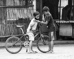 Minor Adustment (Beegee49) Tags: street boys adjustment repair silay city philippines