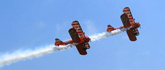 Flying display at Duxford (Snapshooter46) Tags: biplane flyingcircus wingwalkers smoketrail iwm duxford