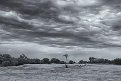 Windmill and stormy skies near Wood River, Nebraska (diana_robinson) Tags: windmill stormyskies stormclouds stormyweather greenfield pasture woodriver nebraska