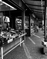 """Italian Products For Sale"" (giannipaoloziliani) Tags: urbanexplorer urbanstreet città capture capturestreets sale nikond3200 nikoncamera nikon nikonphotography streetmarket mercato lightandshadow liguria genova genoa streetlife streetphotography market downtown city flickr monochrome monocromatico blackandwhite biancoenero"