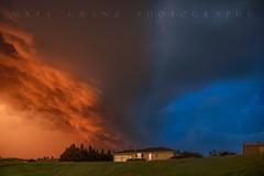 The Golden Blue Hour Storm (Matt Granz Photography) Tags: nebraska weather clouds bluehour goldenhour sunset twilight dusk orange blue homes houses storm centralplains nikon mattgranz therebeastormabrewin