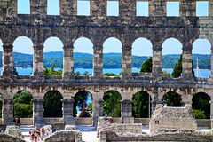 Pula: Roman Arena Sea beyond the arches (ARKNTINA) Tags: pula pulacroatia istria istra europe croatia hr18 eur18 random6 town building architecture sea adriatic adriaticsea mediterranean mediterraneansea arena amphitheater pulaarena romanamphitheater romanarena romanruins ruins