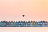 Flying or Sailing? (karindebruin) Tags: houses houten instagram instameet zonsondergang huisjes langesluitertijden longexposure sunset water rietplas colors kleuren hotairballoon luchtballon