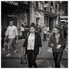 'And he said this, and she said that'... (zapperthesnapper) Tags: sonyrx100 sonyimages sonycybershot sony mono monochrome monochromatic blackandwhite streetlife streetscene street champselysee paris france