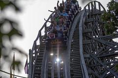 Down the drop (raptoralex) Tags: holidayworld holiwoodnights amusementpark themepark legend rollercoaster customcoasters wood sun sunlight