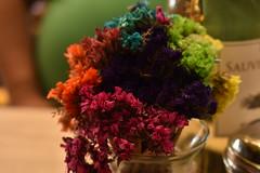 Color et flos (Karen Scarlett Delgado) Tags: flower macro table colors wine nikon d3400