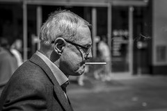 Intake (Leanne Boulton) Tags: portrait urban street candid portraiture profile streetphotography candidstreetphotography candidportrait streetportrait streetlife old elderly man male face expression smoke smoker smoking cigarette wisp tobacco addiction tone texture detail inhaling depthoffield bokeh naturallight outdoor light shade shadow sunlight city scene human life living humanity society culture lifestyle people canon canon5d 5dmkiii 70mm ef2470mmf28liiusm black white blackwhite bw mono blackandwhite monochrome glasgow scotland uk
