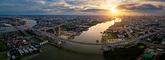 Aerial view panorama of Bhumibol suspension bridge cross over Chao Phraya River in Bangkok city with car on the bridge at sunset sky and clouds in Bangkok Thailand. (MongkolChuewong) Tags: aerial aerialview architecture art asia auto bangkok bay bhumibol bhumipol bridge building car chaophrayariver city cityscape connect connection curve downtown drive drone dusk evening expressway freeway highway industry landmark landscape lane lighttrails motorway night panorama panoramic river roads route sunrise sunset suspension thailand traffic transport twilight urban view vision way krungthepmahanakhon th