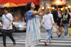 A woman snapping a photo along 49th Street, from Broadway. (kevinrubin) Tags: newyorkcity street streetphotography nyc newyork unitedstates us