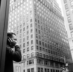 city call (gguillaumee) Tags: film analog grain 6x6 120mm rolleiflex nyc newyork bw blackandwhite building skyscraper mediumformat noiretblanc street streetphotography phone phonecall man