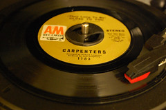 Carpenters 45 On The Turntable. (dccradio) Tags: lumberton nc northcarolina robesoncounty indoor indoors inside 45 45record 45rpm single stylus turntable recordplayer turntableneedle record vinyl wax am carpenters theylongtobeclosetoyou stereo amrecords music old classic antique vintage oldways flickrfriday nikon d40 dslr oldmusic classicmusic hits recorded song spin circle 45adapter victrola victrolaturntable 1183 trumpet horn label sticker words text