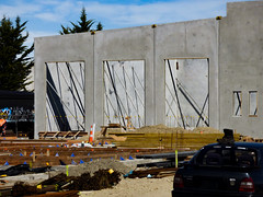Lines of Force (Steve Taylor (Photography)) Tags: architecture building cone roadcone trafficcone construction wall concrete metal wood newzealand nz southisland canterbury christchurch spring cloud boot buildingsite rebar foundations