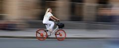 Orange wheels (sneaky winey) Tags: orange wheels street people bicycle white panning