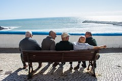 The talk (Nicola Gilg) Tags: sagres color canon lisbon streetphotographyportugal streetphotography blue water old street ericeira portugal ocean sea sit bank men