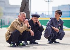 Korean guys chilling in Pyongyang, DPRK (TeunJanssen) Tags: northkorea dprk asia korea chilling men 75mm 75mmf18 olympus omd omdem10 koreans dayofthesun hanging streetphotography travel traveling worldtravel backpacking worldtrip youngpioneertours pyongyang ypt