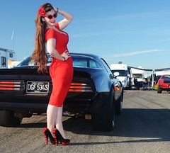 Holly_9149 (Fast an' Bulbous) Tags: pontiac transam car automobile american muscle pinup model girl woman hot sexy red wiggle dress high heels stockings long brunette hair wife