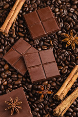 Chopped bitter chocolate with cinnamon sticks and anise stars on coffee beans background (Aleksa Torri) Tags: chocolate cocoa dark wood background cacao healthy food brown sweet natural ingredient dessert bitter closeup tasty black aromatic bar bittersweet block candy close concept eating flavor macro nibs organic square supplement taste artisan stilllife bean coffee coffeebean copyspace confectionery color confection energy chocolatier craftsman craftsmanship cinnamonsticks anisestars pieces chopped broken
