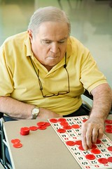 Stock Images (perfectionistreviews) Tags: color indoors retirementhome aging bingo game leisure activity number chip board playing mature adult man male elderly vertical wheelchair senior person recreation assistedliving elderlyman hobby concentation onepersononly gamble caucasian serious portrait senioradult seniorman photograph seniorcitizen sportsandrecreation