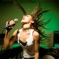 Female singing into mic. (perfectionistreviews) Tags: photograph color indoors square woman female women adult 1819years caucasian onepersononly brunette halflength inside lifestyle music sound band rock rockandroll sexy attractive emotion swinging hair punk modern loud mic microphone singing musician musicians lifestylesandart