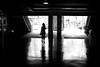 By the left exit (pascalcolin1) Tags: paris13 femme woman lumière light ombres shadows reflets reflection sortie exit porte door photoderue streetview urbanarte noiretblanc blackandwhite photopascalcolin 50mm canon50mm canon