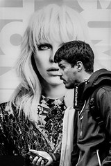 Looking Ahead (EightBitTony) Tags: 2018 person city nottingham female citycentre man urban canon7d2 mobilephone superdry poster woman juxtaposition male june streetphotography blackandwhite uk nottinghamshire bw blackwhite canon canon7dmarkii canon7dmark2 canon7dmk2 canon7dii canondslr canoneos canoneos7dmarkii canoneos7d2 canoneos7dii mono monochrome