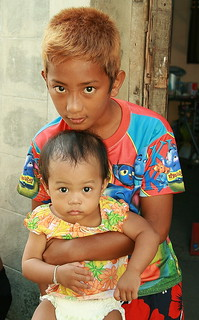 holding up little sister