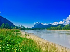 Low water level in the river Inn with Pendling mountain in the background, Tyrol, Austria (UweBKK (α 77 on )) Tags: river inn low water level flow stream pendling mountain alps grass green sky blue tyrol tirol austria österreich europe europa iphone