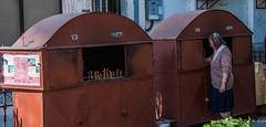 2018 - Romania - Bucharest - Orthodox Church - Candle Cabinets (Ted's photos - For Me & You) Tags: 2018 bucharest nikon nikond750 nikonfx romania tedmcgrath tedsphotos vignetting candles woman female cross shadows padlock greekorthodox morţi vii dead alive