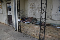 Within 1 block of the North Carolina State Capitol in Raleigh, where politicians and special interest groups recently haggled over what projects to cut and which to fund, a homeless man sleeps. (Apartment 4 G Photography.....) Tags: knightdalenc ncrealtorsassociation housing gentrification affordablehousing triangle bestplacetolive eastwake ikea apple google forbesmagazine liveworkplay south moralmonday reverendbarber naacp aclu relocation protests poorpeoplecampaign startsomething joshstein richardburr senator thomtillis halifaxmall people poverty raleighnc rayriveraphoto rivera wakecounty wake downtownraleigh roycooper governorcooper statesenate legislature 1edentonstreet 27601 raleigh homeless mentalillness
