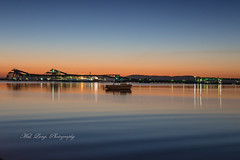 Sunrise over Boston Bay Port Lincoln (Malcom Lang) Tags: winter 2018 sunrise earlymorning light lights wharf jetty boats vessel vessels waves wave ripples ripple reflection reflections bulkloader greenlights calm flat still island atanchor ship sunlight port portlincoln eyrepeninsula eyre lowereyrepenninsula southaustralia southern south southernaustralia southerneyrepeninsula southernocean ocean oceanlife bay bostonbay australia australian aussie canoneos6d canon canon6d canonef2470mm canonef mal lang photography mallangphotography clear glass water sky travel traveling travelaustralia