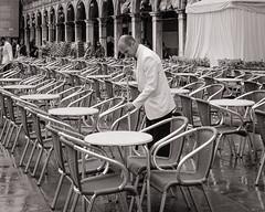 After the Rain. St Mark's Square. Venice. (raymorgan4) Tags: venice venezia italia italy italian st marks square raining fujifilm fujifilmx100f fujifilmglobal x100f acros cafe alfresco waiter sweeping brush cleaning