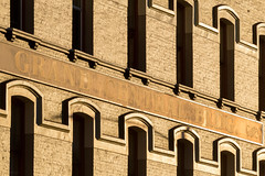 Grand Central Building (josullivan.59) Tags: 2018 artistic bc britishcolumbia canada canon6d tamron150600 victoria abstract architecture detail downtown evening goldenhour historic light lightanddark nicelight old outdoor outside reflection shadow sunset sunsetlight telephoto texture travel wallpaper window yellow