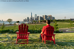 Governors Island View (20180525-DSC07335-Edit) (Michael.Lee.Pics.NYC) Tags: newyork governorsisland lowermanhattan park wtc onewtc worldtradecenter newyorkharbor cityscape architecture chairs outdoors furniture sitting skyline sony a7rm2 fe24105mmf4g
