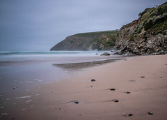 Making the most of a dull morning (NikNak Allen) Tags: mawganporth cornwall beach coast bay sand stones rocks sea water ocean smooth cliff cliffs morning low longexposure seascape landscape sky waves surf