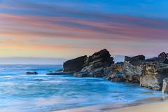 Rocky Outcrop Sunrise Seascape (Merrillie) Tags: daybreak sunrise cloudy australia nsw centralcoast clouds sea newsouthwales rocks earlymorning morning water landscape ocean nature sky waterscape coastal seascape outdoors killcarebeach dawn coast killcare waves