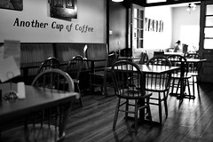 Another Cup of Coffee (l i v e l t r a) Tags: decorah tables coffee shop people café monochrome empty iowa background f14 fx girls light