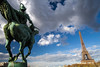 the equestrian statue and the tower (nzfisher) Tags: statue tower equestrian eiffel eiffeltower sky clouds cloudy landscape cityscape landmark blue orange paris france holiday travel 24mm canon horse