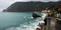 view of Monterosso (scott1346) Tags: water rock sea shore waves colors blue green mountain town cinque terra italy seaside village vacation 1001nights canont3i 1001nightsmagiccity thegalaxy autofocus